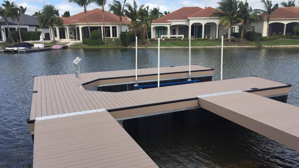 "Floating walk-around dock with Azek decking and patented ""Nel-Sun"" lift system"