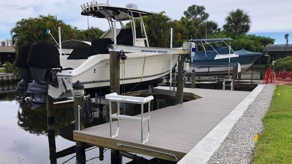 10,000 lb. Quality boat lift with standard angled vinyl dock, featuring a high density plastic, aluminum framed fish cleaning table. Fort Myers Beach