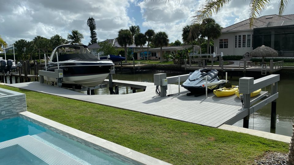 Poolside dock with two lifts & multiple watercraft