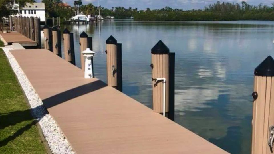 Residential dock with Azek vinyl decking and piling strips, low level lighting, heavy duty boat fenders. Naples